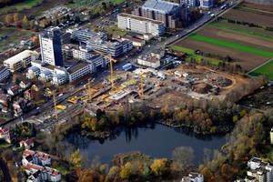 """Fig. 1 The new residential quarter """"Seepark am Probstsee"""" is being built about 1 km  away from the center of Möhringen, an urban district of Stuttgart/Germany.   Abb. 1 Etwa 1 km vom Zentrum des Stuttgarter Stadtbezirks Möhringen entfernt entsteht  das neue Wohnquartier Seepark am Probstsee."""