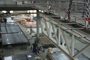 "<div class=""bildtext_en"">In one of two production buildings, steel reinforcement is straightened, cut and welded by Progress plants installed on a platform prior to being placed, through an opening, on a pallet of the circulation system on the ground floor </div>"