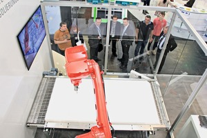 "<div class=""bildtext_en"">Crowd puller: At Bauma, Vollert Anlagenbau presented the improved ­version of the Iso-Matic process station. Water jet cutting was imitated by means of a laser beam</div>"
