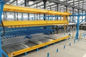 Magnetic crossbeam for inserting the reinforcement wire mesh produced into the ­prepared pallets