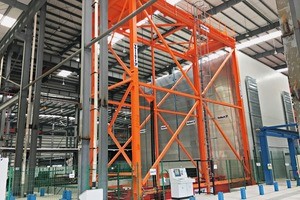 "<div class=""bildtext_en"">The insulated and heated shelf towers in the curing chamber are activated via the Vario stacker crane</div>"