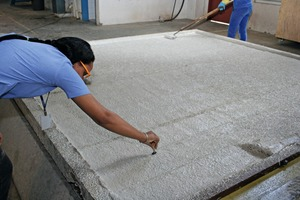 "<div class=""bildtext_en"">... extending up to regular inspection of the precise layer thicknesses while the fresh concrete is evenly distributed with the application roller</div>"
