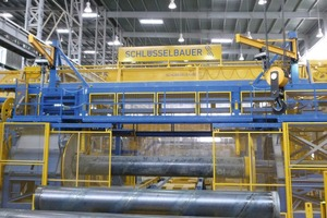 """<div class=""""bildtext_en"""">The prestressing wire is automatically wound to the concrete steel cylinder at a speed of up to 6 m per second</div>"""