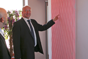 Reckli sales director, Alexander Turpakov (right), presents the pink concrete panels in the interiors
