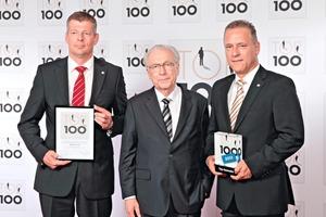 "<span class=""bildunterschrift_hervorgehoben"">Fig. 1</span> Prof. Dr. Lothar Späth gives the award to Jörg Rasbieler and Holger Stichel, the managing partners of KOBRA Formen GmbH.<br />"