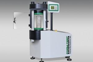"<div class=""bildtext_en"">The new Beta 5-3000 AD pressure testing machine, open, with test specimen</div>"