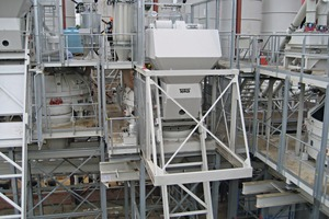 """<div class=""""bildtext_en"""">Four mixing stations are equipped with planetary mixers of type TPZ 3,750 with an output rate of 2.5m³ per batch, one mixing station with a Teka high-performance Turbine Mixer THT 1,500</div>"""