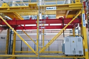 """<div class=""""bildtext_en"""">A floor-guided storage and retrieval machine puts freshly concreted concrete shells into the curing chamber situated on the opposite side</div>"""
