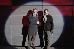 "<div class=""bildunterschrift_en"">Prof. Thomas Gries and Dr. Andreas Roye standing in the limelight in front of the new façade</div>"