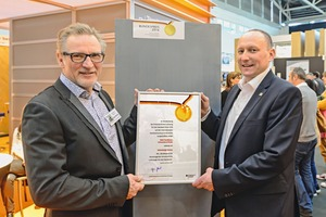 """<div class=""""bildtext_en"""">Bernhard Kölsch, Managing Director of Betondesign-factory (left), and Roy Thyroff, Managing Director of V. Fraas Solutions in Textile, at the ceremony during presentation of the Federal Award for Outstanding Innovations for Crafts and Trades</div>"""