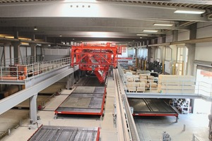 "<div class=""bildtext_en"">The carrousel plant for the manufacture of double walls supplements the company's portfolio. In the adjacent hall, lattice girder floors and precast stairs are already manufactured</div>"