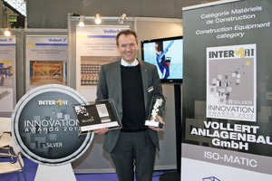 The Vollert booth showing the Innovation Award at Intermat in Paris: Philippe Marrié was very pleased about the Silver Award 2012