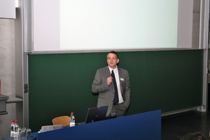 Markus Greim moderating the conference in Regensburg