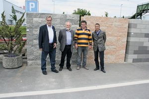 """<div class=""""bildtext_en"""">General Manager, Michel Cornaz (2nd left), together with his team welcome Alexander Eysink in front of one of the example walls</div>"""