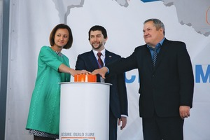 The Samara region's Minister for Construction, Oksana Anatolevna Bistrova together with Alexander Mondrus, Managing Director of MC Russia, and Alexander Prokudin (from left to right), First Deputy of the Head of Kinel City District, attend the official opening of the new MC plant in Alekseevka
