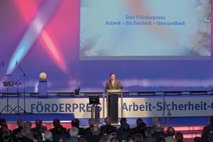 "<span class=""bildunterschrift_hervorgehoben"">Fig. 1</span> Helmut Ehnes, head of the division prevention of BG RCI, on stage of the award ceremony.<br />"