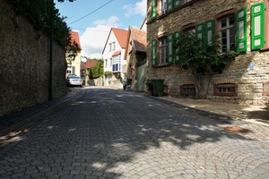 """<div class=""""bildtext_en"""">After: the ArcoStrada segmental arch pavement combines the attractive appearance of small paving blocks with the benefits of easy-to-walk-on, heavy-duty concrete pavers </div>"""