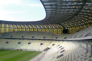 The undulating precast grandstands pick up on the Baltic Sea as a theme