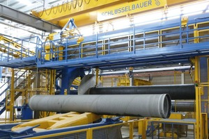 """<div class=""""bildtext_en"""">All manipulation needed for the semi-finished pressure pipes are carried out fully-automatically</div>"""